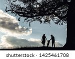 silhouette of family on the... | Shutterstock . vector #1425461708