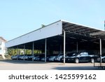 many cars parked under a large... | Shutterstock . vector #1425599162