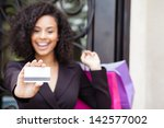 pretty woman smiling holding a... | Shutterstock . vector #142577002