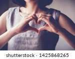 Woman Making Hands In Heart...
