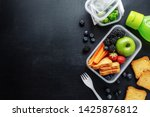 Small photo of Healthy lunch to go. Fruits and vegetables packed in lunch box. Healthy eating concept. View from above with copy space.