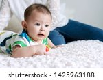cheerful cute baby boy lying on ... | Shutterstock . vector #1425963188