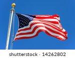 Usa Flag Waving Over A Blue Sky ...