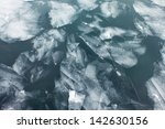 closeup of ice floes on a lake | Shutterstock . vector #142630156