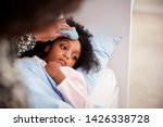 mother caring for sick daughter ... | Shutterstock . vector #1426338728