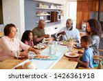 multi generation family sitting ... | Shutterstock . vector #1426361918