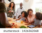 grandparents sitting at table... | Shutterstock . vector #1426362068