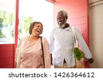 mature couple returning home... | Shutterstock . vector #1426364612