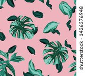 green tropical monstera leaves... | Shutterstock .eps vector #1426376948