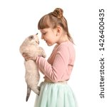 Stock photo girl with cute fluffy kitten on white background 1426400435