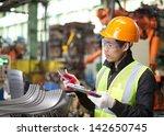 worker in factory checking... | Shutterstock . vector #142650745
