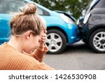 female motorist with head in... | Shutterstock . vector #1426530908