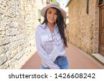 young pretty woman smiling.... | Shutterstock . vector #1426608242