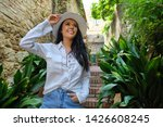 young pretty woman smiling.... | Shutterstock . vector #1426608245