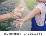 Stock photo hand spraying insect or mosquito repellents on skin girl mosquito repellent for babies toddlers 1426611968