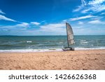 Sail Boat Catamaran On The Beach