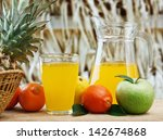 variety of fruit and juice on a ... | Shutterstock . vector #142674868