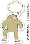 Stock vector cartoon bigfoot with thought bubble as a printed sticker 1426814768