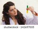 Female Scientist Performing...