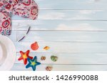 beach accessories on blue plank ... | Shutterstock . vector #1426990088