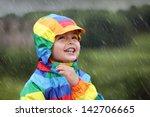 Little Boy Enjoying The Rain...