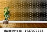 golden black brick walls with...   Shutterstock . vector #1427073335