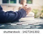 man holding a bible in her... | Shutterstock . vector #1427241302