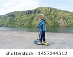 3 year old boy in mountain park | Shutterstock . vector #1427244512