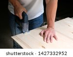 carpenter is sawing a plywood... | Shutterstock . vector #1427332952