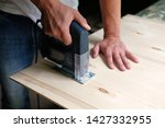 carpenter is sawing a plywood... | Shutterstock . vector #1427332955