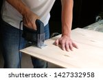 carpenter is sawing a plywood... | Shutterstock . vector #1427332958