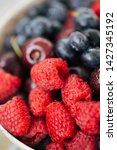 macro raspberries and other...   Shutterstock . vector #1427345192
