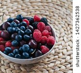 bowl filled with berries on on...   Shutterstock . vector #1427362538