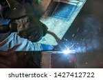 worker in a protective wardrobe ...   Shutterstock . vector #1427412722