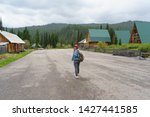 woman with backpack walking in... | Shutterstock . vector #1427441585
