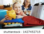 happy stylish mother and...   Shutterstock . vector #1427452715