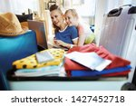 smiling modern mother and child ...   Shutterstock . vector #1427452718