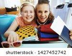 portrait of happy stylish...   Shutterstock . vector #1427452742