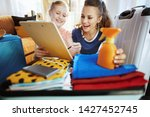 happy stylish mother and child...   Shutterstock . vector #1427452745