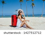 woman on the sand near the red...   Shutterstock . vector #1427512712