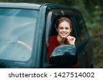 cheerful pretty woman driving...   Shutterstock . vector #1427514002