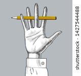 hand with a pencil between her... | Shutterstock .eps vector #1427544488