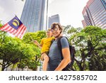 dad and son tourists in...   Shutterstock . vector #1427585702