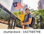 dad and son tourists in...   Shutterstock . vector #1427585798