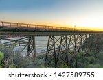 old railway and car bridge near ... | Shutterstock . vector #1427589755