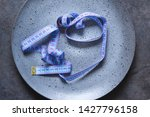 empty plate with a tape measure ... | Shutterstock . vector #1427796158
