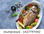 baked dorado with spices  with... | Shutterstock . vector #1427797442