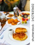 delicious pancakes served for... | Shutterstock . vector #1427835602