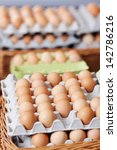 Closeup Of Eggs On Cartons At...