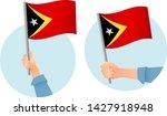east timor flag in hand.... | Shutterstock .eps vector #1427918948